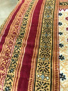Hand-stitched quilt